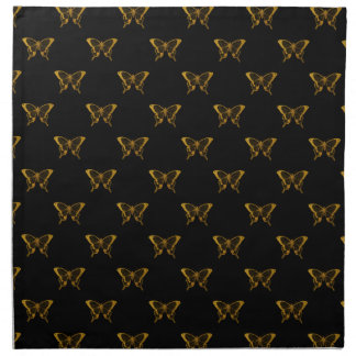 Metallische Goldfolien-Schmetterlinge auf Serviette
