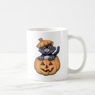 Miezekatze in einem Kürbis Kaffeetasse