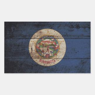 Minnesota-Staats-Flagge auf altem hölzernem Korn Rechteckiger Aufkleber