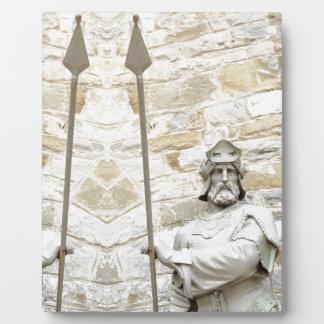 Mittelalterlicher Hintergrund mit Ritter in der Fotoplatte