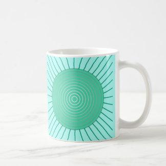 Moderner geometrischer Sonnendurchbruch - Aqua und Kaffeetasse