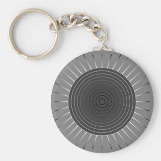 Moderner geometrischer Sonnendurchbruch - dunkles Schlüsselanhänger