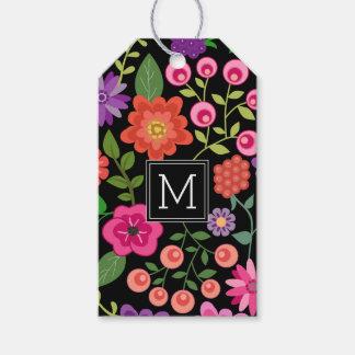 Modisches schwarzes Blumenmuster mit Geschenkanhänger