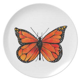 Monarchfalter-Illustration auf großem Teller