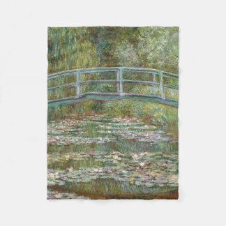 Monet Kunst-Brücke über einem Teich der Fleecedecke