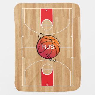 Monogramm-Basketball auf Basketballplatz Babydecke