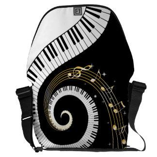 Monogramm-Klavier-Schlüssel und musikalische Kurier Tasche