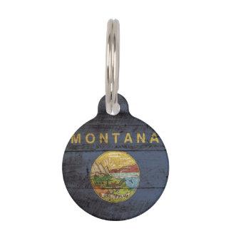 Montana-Staats-Flagge auf altem hölzernem Korn Tiernamensmarke