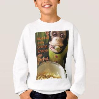 Musikalischer lustiger Schimpanse genießt sein Sweatshirt