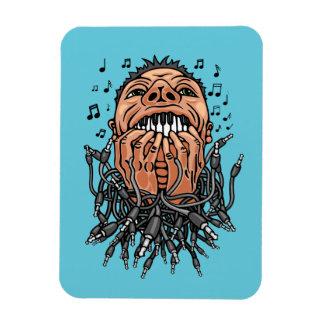 Musiker spielt auf seinen Zähnen wie auf Tastatur Magnet