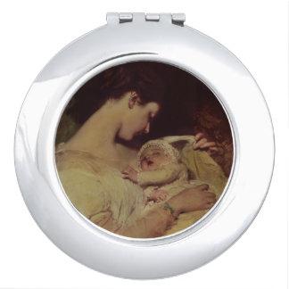 Mutter, die ihr Baby hält Taschenspiegel