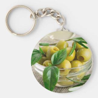 Narbige Oliven mit grünem Blätter und Rosmarin Schlüsselanhänger