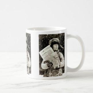 Nexspaper Verkäufer Kaffeetasse