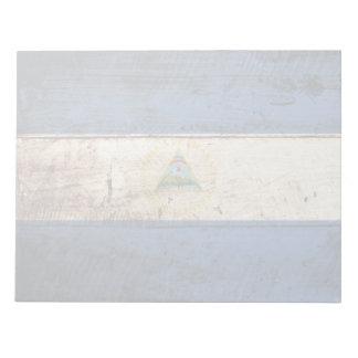Nicaragua-Flagge auf altem hölzernem Korn Notizblock