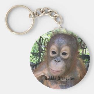 Niedliche Baby-Orang-Utan Waise in Borneo Schlüsselanhänger