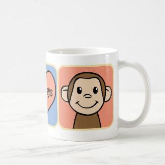 Niedliche Cartoon-Klipp-Kunst-Affen mit Herz-Liebe Kaffeetasse
