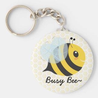 Niedliche gelbe schwarze beschäftigte Biene mit Schlüsselanhänger