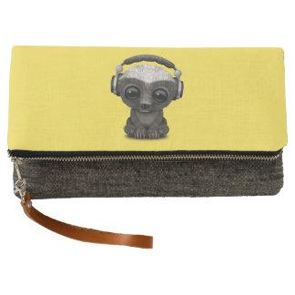 Niedliche tragende Kopfhörer Baby-Honig-Dachs-DJ Clutch