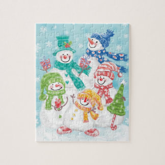 Niedliche Weihnachtssnowman-Familie im Schnee Puzzle