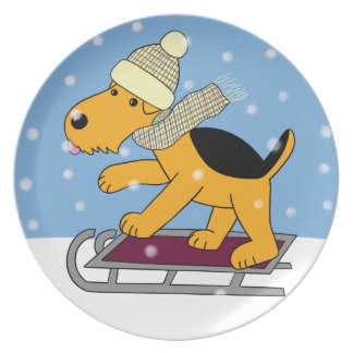Niedlicher Airedale-Terrier-Hund auf Melaminteller