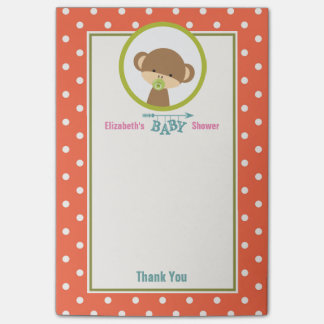 Niedlicher Baby-Affe mit einem Schnuller auf Post-it Klebezettel