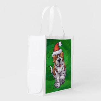 Niedlicher Bernhardiner in der Weihnachtsmannmütze Wiederverwendbare Einkaufstasche