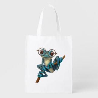 Niedlicher blauer Baum-Frosch mit Augen-Gläsern Einkaufstaschen