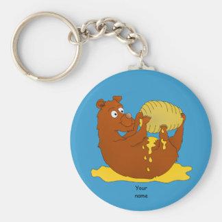 Niedlicher Cartoon-Bär, der Honig isst Schlüsselanhänger