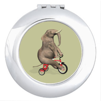 Niedlicher Elefant, der ein Dreirad reitet Taschenspiegel