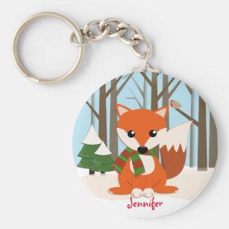 Niedlicher Fox in einem schneebedeckten Wald u. in Schlüsselanhänger