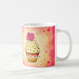 Niedlicher gelb und rosa Cupcake mit Rose und Herz Kaffeetasse