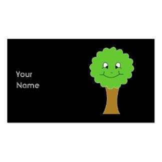 Niedlicher glücklicher grüner Baum. Auf Schwarzem Visitenkarten