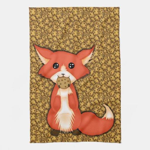Niedlicher großer mit Augen Fox, der ein Plätzchen Küchenhandtücher