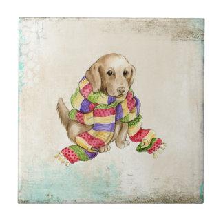 Niedlicher inländischer Hunde- Hund mit einem Keramikfliese