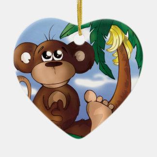 Niedlicher kleiner Affe, der nahe bei Bananen-Baum Keramik Ornament