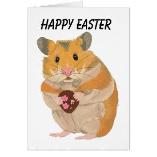 Niedlicher kleiner Hamster, der ein Osterei hält Karte