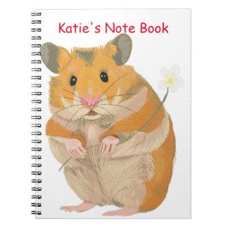 Niedlicher kleiner Hamster, der eine Blume hält Notizblock