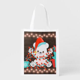 Niedlicher kleiner polarer Bär mit Wiederverwendbare Einkaufstasche