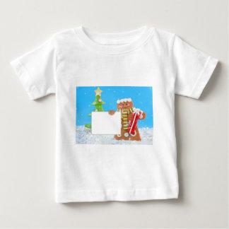 Niedlicher Lebkuchenmann, der ein Zeichen hält Baby T-shirt