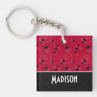 Niedlicher rosa und schwarzer Marienkäfer Schlüsselanhängern