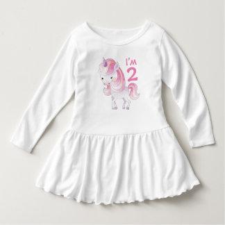 Niedlicher rosa Unicorn mit dem Alter des Kindes Kleid