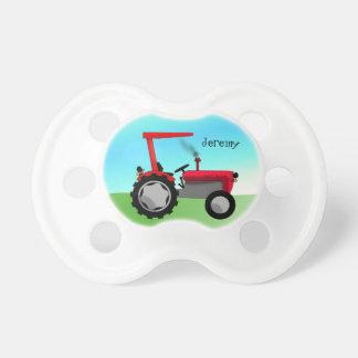Niedlicher roter Bauernhof-Traktor Schnuller