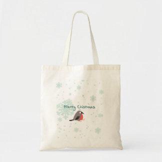 Niedlicher Vogel und Schneeflocke der Tragetasche
