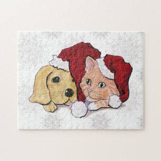 Niedlicher Weihnachtslabrador-Welpe und orange Puzzle