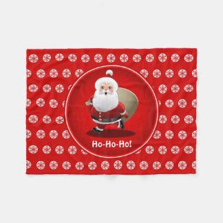 Niedlicher Weihnachtsmann mit einem Sack voll von Fleecedecke