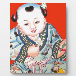 Niedliches chinesisches lachendes viel Glück Fotoplatte