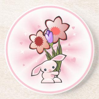 Niedliches rosa Häschen mit Blumen Ostern Getränkeuntersetzer