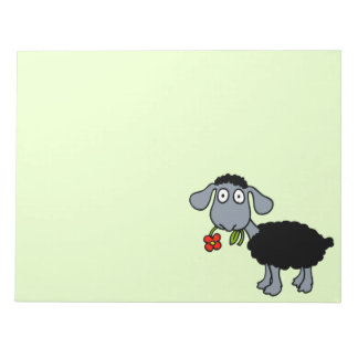 Niedliches schwarze Schaf-Cartoon-Lamm mit roter Notizblock