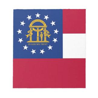Notizblock mit Flagge von Georgia-Staat