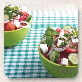 Nützliche vegetarische Nahrung von den rohen Getränkeuntersetzer